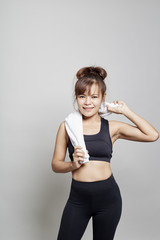 Sport woman holding towel around neck