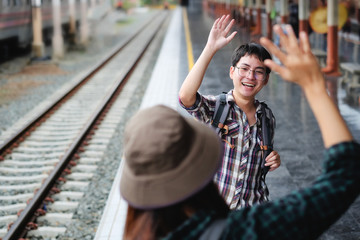 Men Hands High Five Meeting Greeting on train station.
