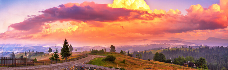 Photo sur Toile Grenat Summer colorful sunset in mountains. Panorama of beautiful evening