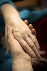 Hands of elderly woman with alzheimer