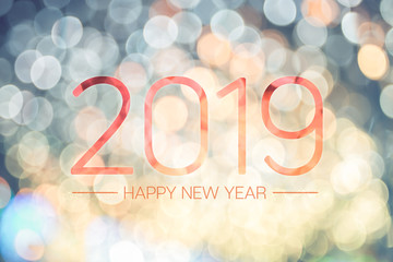 Happy new year 2019 with pale yellow bokeh light sparkling background,Holiday greeting card.