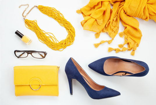 Bright yellow accessories and blue shoes for girls and women. Urban fashion, beauty blog concept