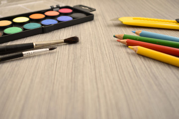 Back to school border stock images. Art supplies on a wooden background. School supplies for painting