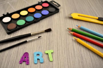 Art supplies stock images. Back to school. Art supplies on a wooden background. School supplies for painting