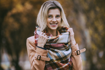 Stylish woman in the autumn park with yellow leaves
