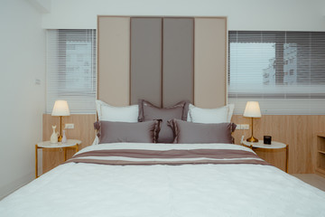 Modern and cosy design of the master bedroom in apartment building
