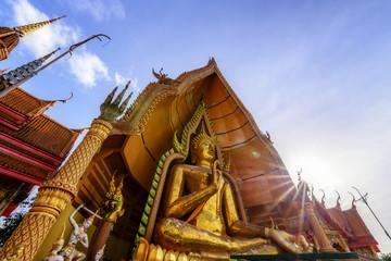 Golden Buddha statue at Wat Thum Sua, Kanchanaburi Province, Thailand