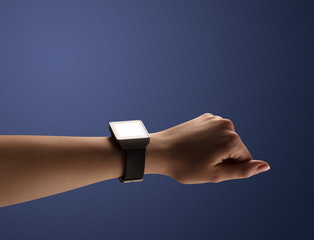 Close up female hand with smartwatch and dark background and black screen