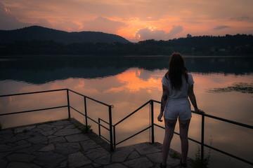 beautifull alternative model young tattoed posing at lake during sunset
