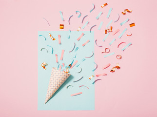 birthday hat with confetti on paper background