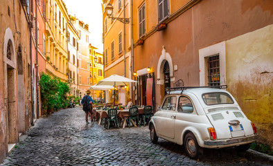 Stores photo Rome Cozy street in Trastevere, Rome, Europe. Trastevere is a romantic district of Rome, along the Tiber in Rome. Turistic attraction of Rome.