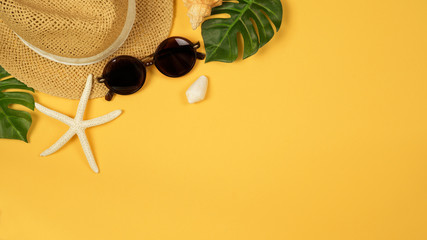 Summer background with straw hat and sunglasses