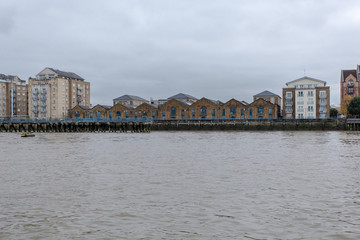 Empty buildings along the Thames river