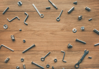 Collection set of house repair tools, wrenchs, screw, bolts on wood table background,flat lay pattern