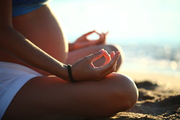 pregnant girl doing yoga sand beach sea