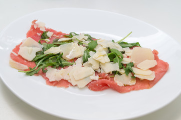 Beef carpaccio with parmesan, rocket and balsamic vinegar