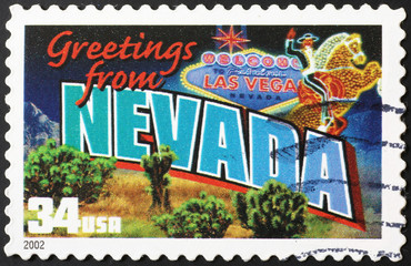Greetings from Nevada postcard on stamp
