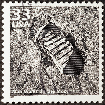 Postage stamp with human footprint on the Moon