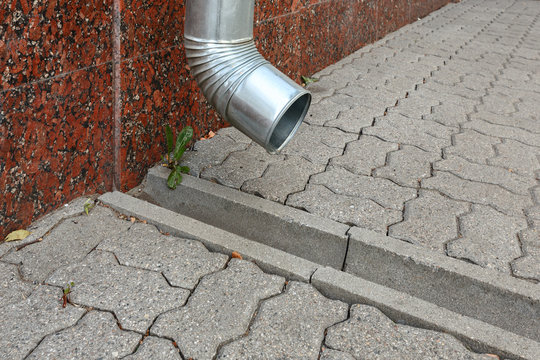 Galvanized steel drainage pipe and a concrete tray for rain water drainage