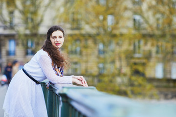 Woman in white dress on Bir-Hakeim bridge in Paris, France