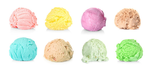 Ice cream scoops of different flavors on white background