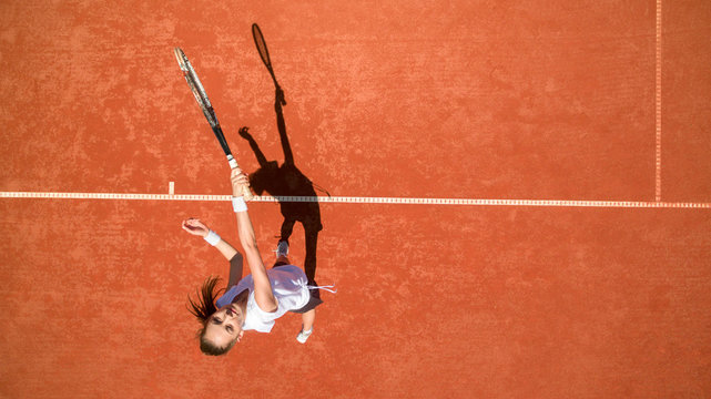 Top view of female tennis player on tennis court