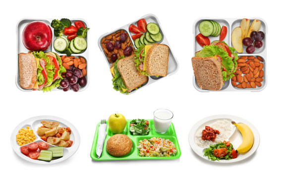 Set of serving trays with food for school lunch on white background