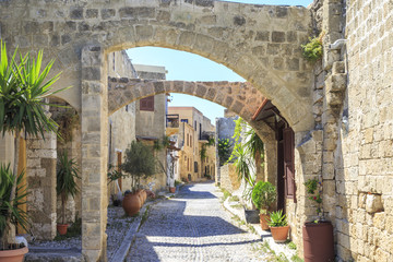 Historical streets of old town Rhodes with flowers in Rhodes, Dodecanese, Greece
