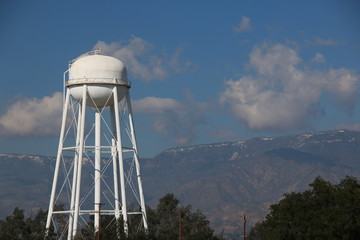 Water Tower with Mountains