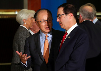 World Bank president Kim talks to U.S. Secretary of the Treasury Mnuchin as IMF Managing Director Lagarde walks behind them after the official photo at the G20 Meeting of Finance Ministers in Buenos Aires