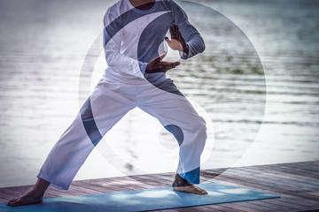 Man hands doing Tai Chi or Tai ji with Yin Yang symbol, Traditional Chinese martial arts.