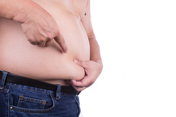 Men pinching unhealthy big belly with visceral or subcutaneous fats