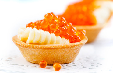 Salmon caviar. Tartlets with red caviar closeup. Gourmet food. Seafood. Trout caviar