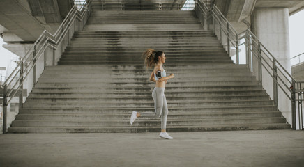 Young woman running in the urban environment
