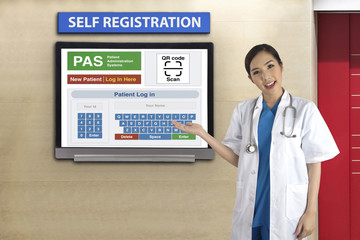 Wall Mural - Female doctor introduced patient administration system for self registration.