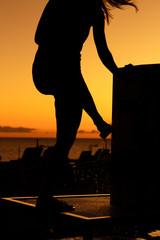 Person vor Sonnenuntergang