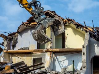 Excavator demolishing a house, Bavaria, Germany, Europe