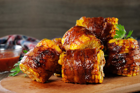 Grilled corn wrapped in bacon