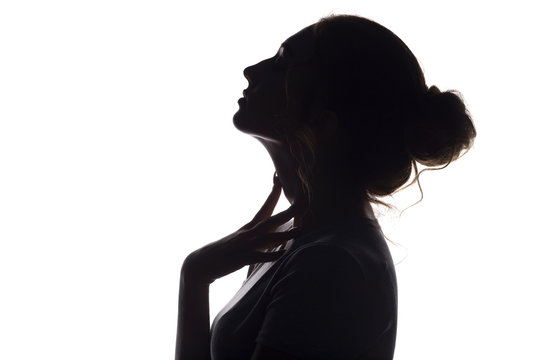 silhouette of beautiful sensual girl, woman face profilee on white isolated background, concept of beauty and fashion
