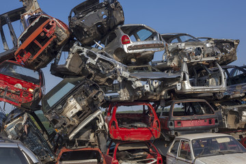 Damaged old cars are waiting for recycling