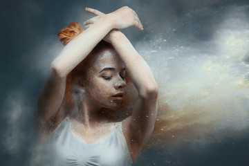 Canvas Prints People Dancing in flour concept. Cute fitness beauty redhead woman / female / adult dancer performer in dust / fog. Portrait of a girl dancer with ginger hair in flour on isolated backround