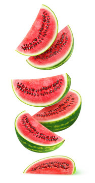 Isolated watermelon slices. Pieces of watermelon fruit flying in the air isolated on white background with clipping path