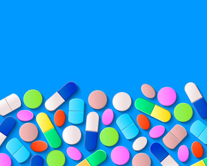 Various pills, tablets and capsules on blue background. Pharmaceutical medicine concept.