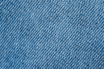 Blue fabric pattern texture background. top view of jeans cloth textile surface.