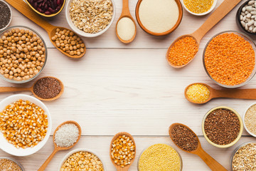 Cereals and legumes assortment on wooden table