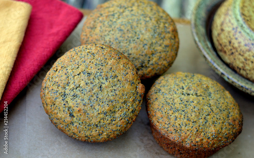 Three Honey ,Poppy Seed Muffins: close-up, high angle view
