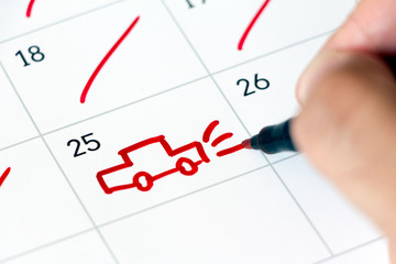 Marking a trip on calendar. Drawing a car. Vacation concept