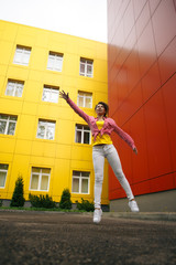 Beautiful brunette girl jumping, walking in the air. . Sad face with a glimmer of hope to escape from the routine of everyday life. Fantasy photo, creative color.