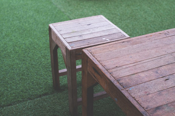 Wood table and chair on outdoor cafe background