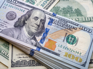 Closeup American dollars banknote. One hundred dollar banknote. earning money & saveing money Concept.
